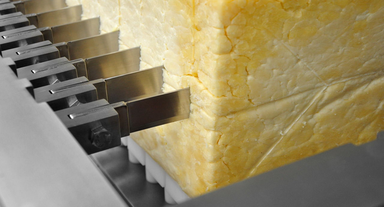 Block cheese, butter or solid fat cutting machine